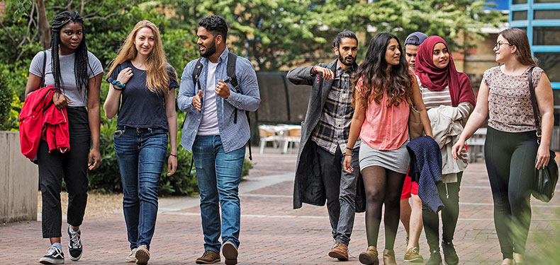 Students walking about QMUL campus