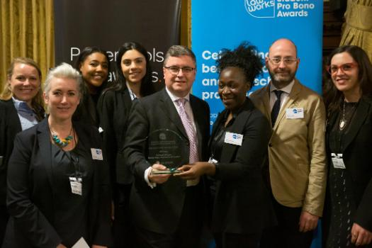 Legal Advice Centre and qLegal accepting their pro bono award
