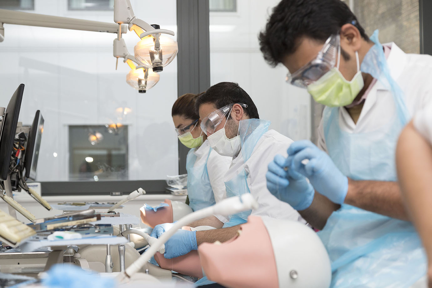 Dentistry students training using a simulation dummy