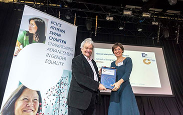 Dr Anna Dulic-Sills receiving the Athena SWAN award on behalf of the School of Geography, from Sir Paul Nurse