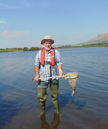 Professor Horne collecting ostracod samples at Loch Leven, Scotland