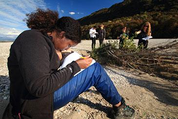 IMFE student Amina Sheikh-Osman taking notes on the Tagliamento field trip