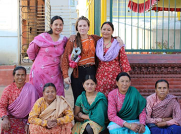 Suzy (top row, middle) pictured here with a group of widowed women in Nepal. Sushma (top left) is a social activist working for Women for Human Rights (WHR). She runs the widows group in her area where she provides adult education classes and teaches other widowed women about their rights