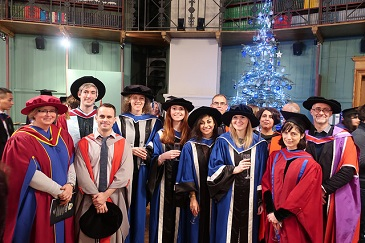 PhD graduates Giuditta Trinci, Eilidh Reid, Hayley Peacock and Victoria Pickering (middle) with staff from the School