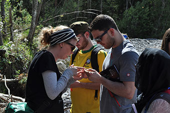 Dr Gemma Harvey (left) helps students explore the river environment.