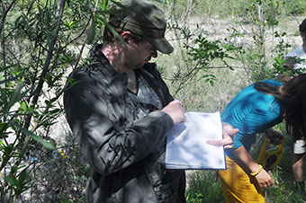 QMUL graduate Peter Duffell taking notes on the Tagliamento field trip.