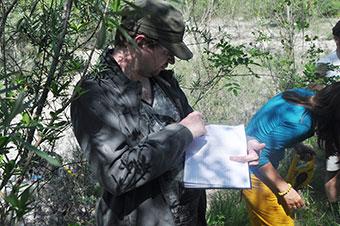 QMUL graduate Peter Duffell taking notes on the Tagliamento field trip.