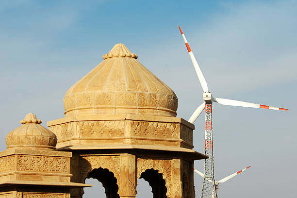 A cenotaph and windmills provide a contrasting image of India