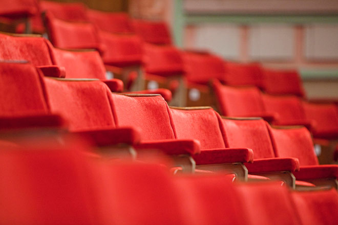 Red Chairs in the Great Hall auditorium.