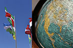 Image of flags blowing in the wind on the left and a globe on the right