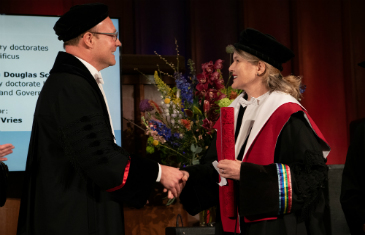 Professor Sionaidh Douglas-Scott receiving an honorary doctorate in her robes