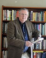 Professor Robert W. Gordon at a book shelf