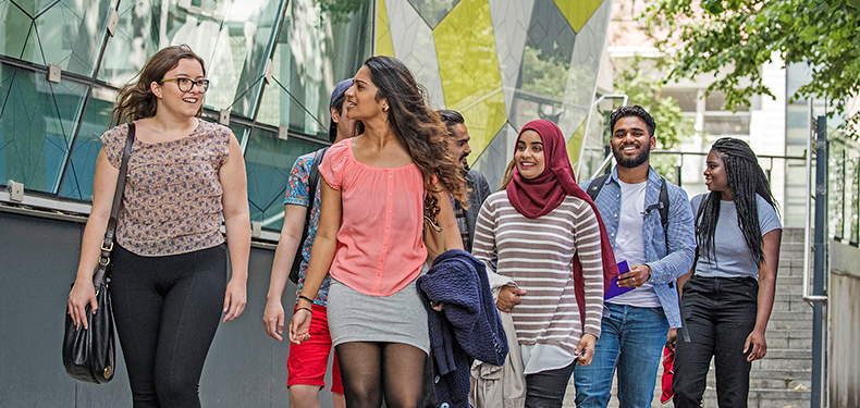 Undergraduate students walking through Mile End Campus