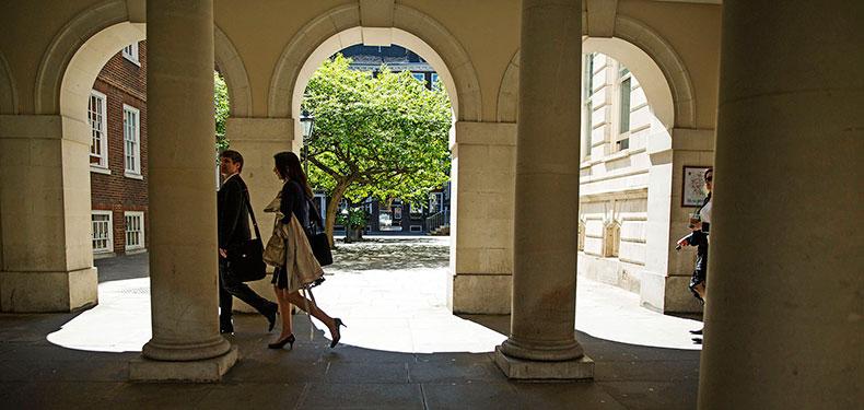 People walking around Temple in London
