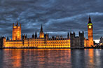 Landscape image of the UK Houses of Parliament at night.