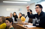Students in a law lecture at Queen Mary, one student is raising their hand to ask a question