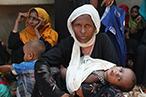 Rohingya refugee woman cradling her baby