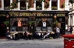 Patrons sat outside the Sherlock Holmes pub in London