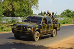 LTTE soldiers in a camouflage patterned car
