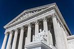 US Supreme Court Building against a blue sky