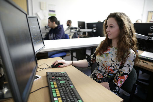 QMUL student working at a computer