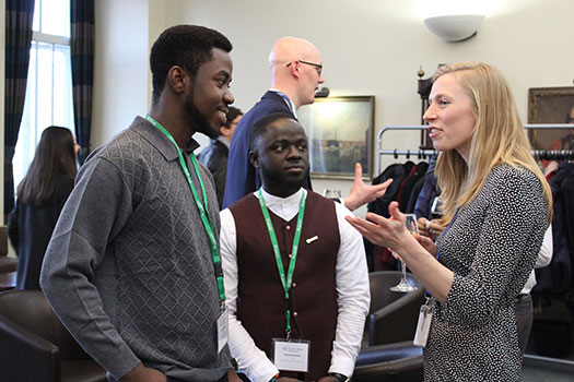 Attendees chatting at the International Scholars Reception 2019