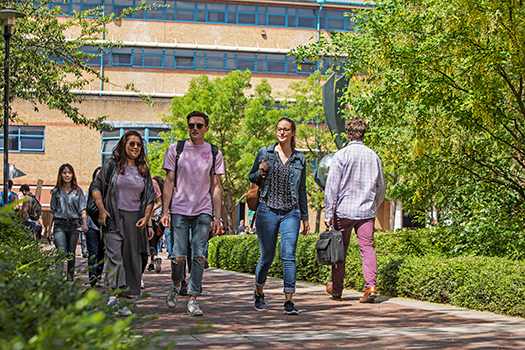 Students walking around queen mary campus