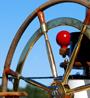 Ship wheel against a blue sky