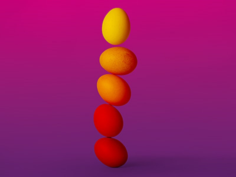 stack of eggs with purple gradient background