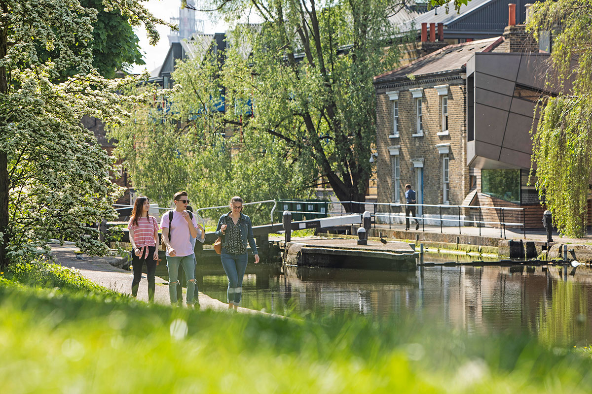 Students walking by the Regent's Canal next to our Mile End campus