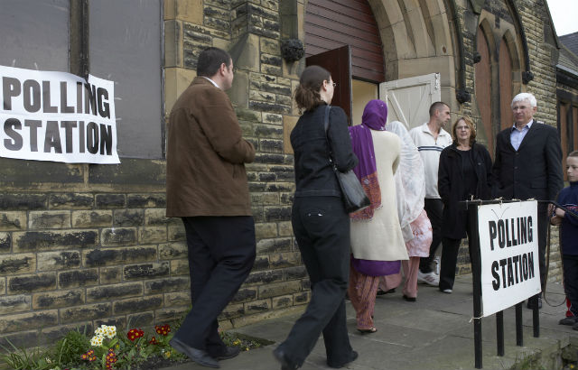 People entering a polling station