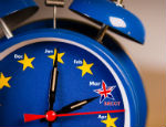 Alarm clock with the colours of the EU flag and one UK star representing the countdown to Brexit.