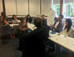 Photograph: Academics working during the interdisciplinary workshop at Queen Mary