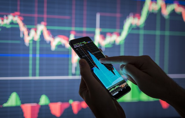 A person checking stock market data on a smartphone