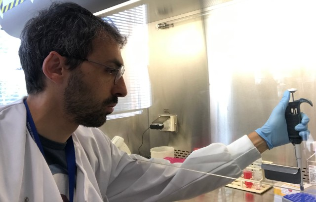 Gianmichele Massimo working in his laboratory