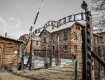 A photograph of the entrance to the Auschwitz concentration camp
