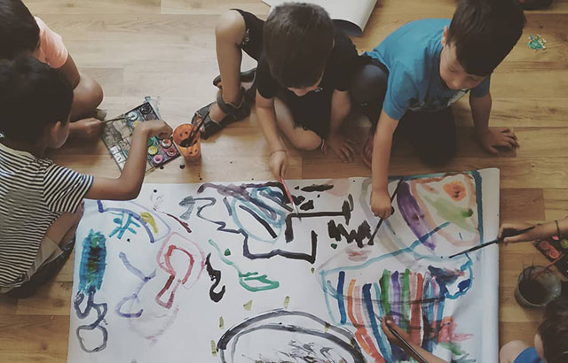 Children painting during the Strengths for the Journey program. Credit: Queen Mary