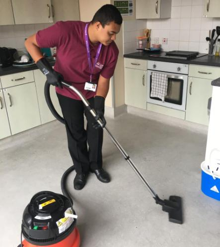 Intern Yusuf working with the residential cleaning team
