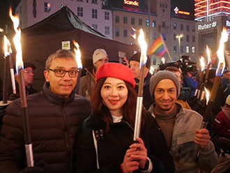 Professor David McCoy, Miranda Liang and Krishen Samuel at the torch procession in Oslo, Norway