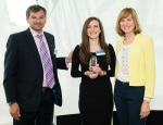 Aysel (centre) collecting her award from Fiona Bruce and David Bearfield, Director, European Personnel Selection Office, EU Careers