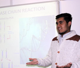 Fahim Ali, a Year 13 student taking part in the project, presents the group's work