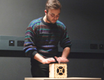 Classical guitarist Michael Poll tries out the experimental digital music cube