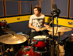 The software allows drummers to set their own pace with pre-programmed music