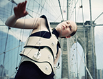 An artist plays the Brooklyn Bridge as part of the Human Harp project