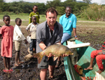 Dr Jonathan Grey, with a common carp caught by local fishermen. Despite having been introduced into Lake Naivasha only 10 years ago, carp now dominates the fishery return, and is indicative of the degraded water quality of the lake.