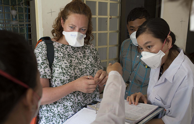 Dr Jess Potter examines a patient's record on an MDR-TB ward in Phnom Penh, Cambodia. Credit: Tom Maguire/RESULTS UK