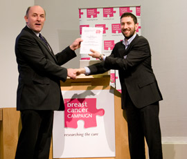 Claudio Raimondi receiving the award from Breast Cancer Campaign
