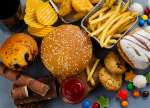 Selection of unhealthy foods and drink.Credit: happy_lark/iStock.com