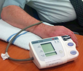 A patient has his blood pressure tested