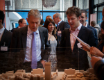President and Principal Simon Gaskell looking over the model of Whitechapel development